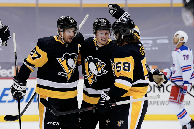 Pittsburgh Penguins players congratulating themselves