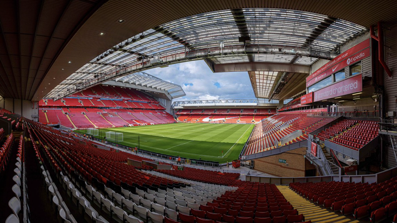 Anfield football stadium in Liverpool displaying sponsors ads