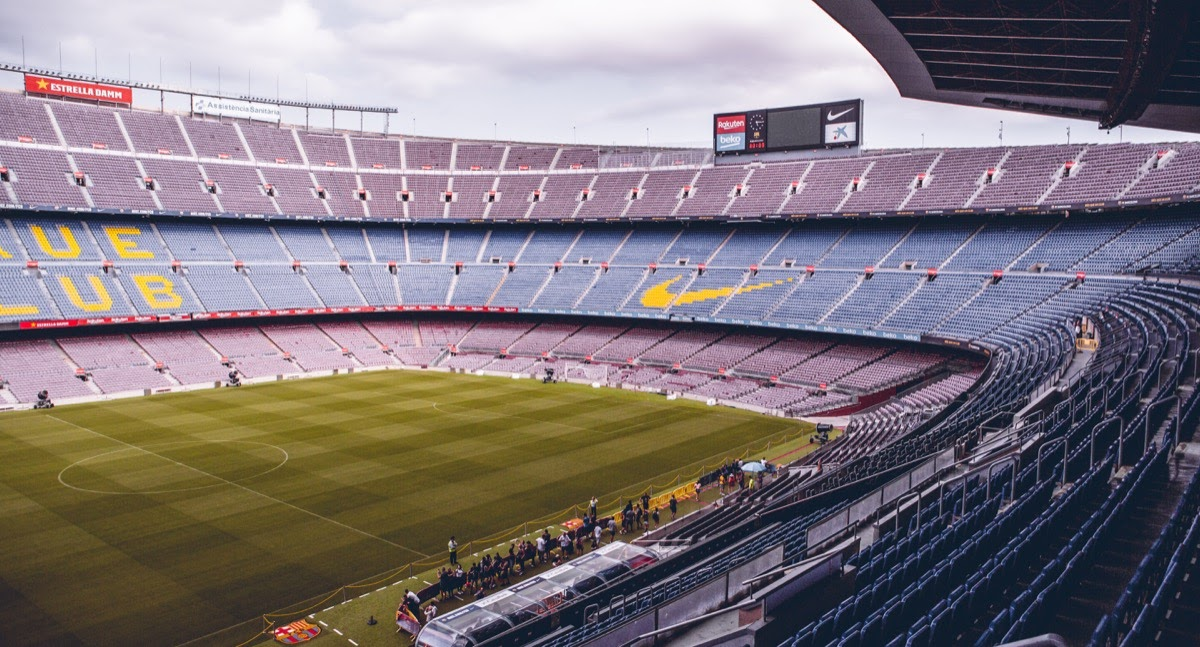 empty soccer stadium with brand logos on the seats; media value equivalency concept